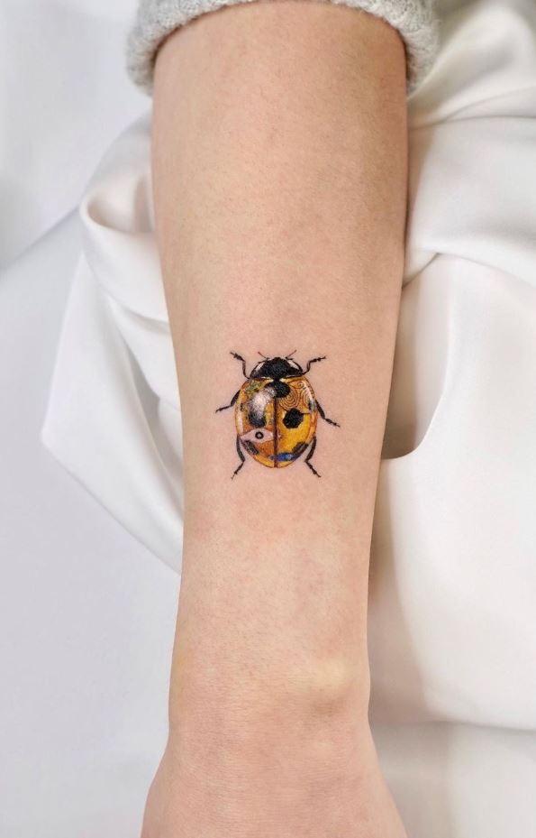 Golden Ladybug Tattoo